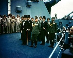 Shigemitsu (with cane) on USS Missouri, Tokyo Bay, 2 September 1945 (Wikipedia Commons)