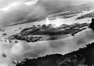 "7 December 1941. Japanese Caption: ""Full view of Ford Island gasping under the attack of our Sea Eagles. This distant view of Ford Island immediately after the attack of our assault force shows the enemy capital ships lined up on the opposite side of the Island. in the foreground is the cruiser fleet, including the battleship UTAH. The enemy ships around the island have all become tempting targets for our Sea Eagles. In the upper right clearly appear the outlines of two of our Sea Eagles who are carrying out a daring low-level attack, reminiscent of the performance of the Gods."" (Wikimedia Commons)"
