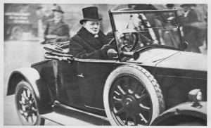 Driving what appears to be a Wolseley, Birdcage Walk, Westminster, 1925. (Churchill was then Chancellor of the Exchequer.) Note the ding in the right front fender!