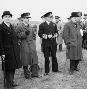 Lindemann, Air Marshal Portal, Admiral Cunningham and Churchill watching an antiaircraft gunnery exhibition, June 1941. (Imperial War Museum)